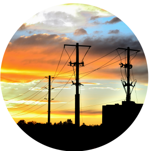 A circle of power lines in the sunset